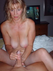 Mature mom two-finger handjob